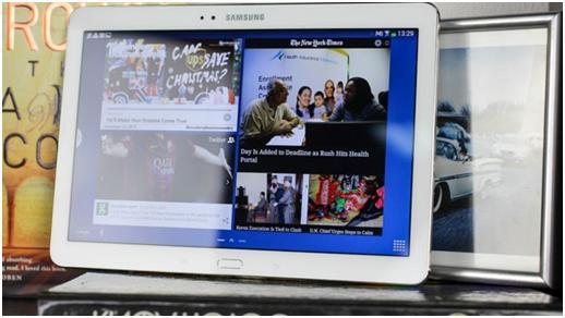 Фото на экране планшета